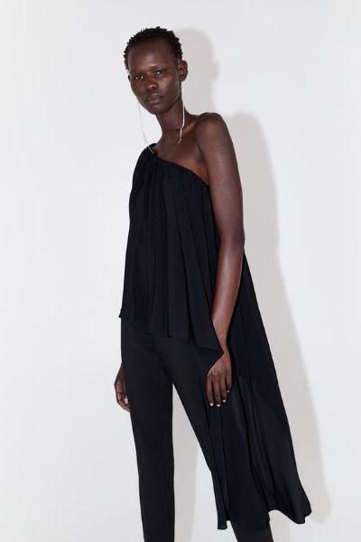 Top negro con cuerpo asimétrico