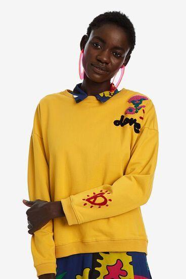 Sudadera amarilla con detalles de Desigual