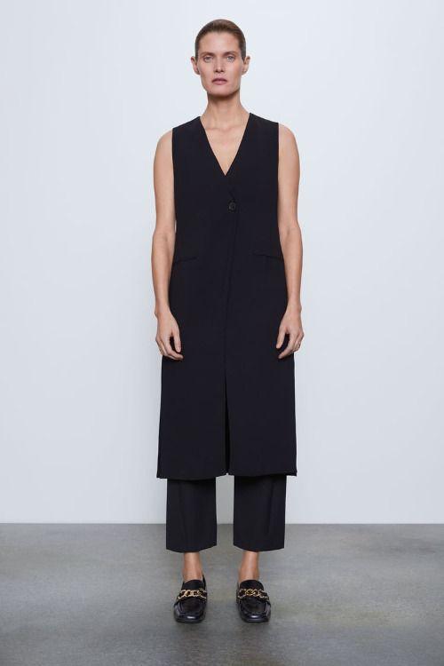 Chaleco largo negro con botón de Zara