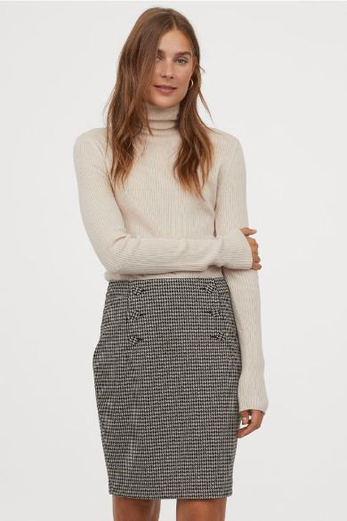 Falda con estampado de cuadros hasta la rodilla de H&M