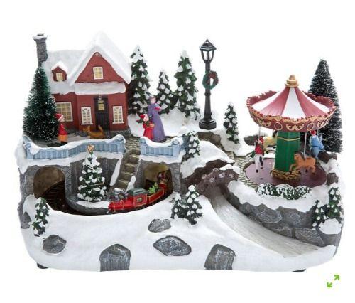 Casita animada de Navidad con tiovivo