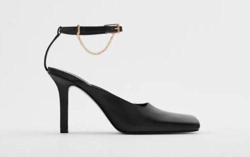 Zapatos destalonados de piel con puntera cuadrada y cadena